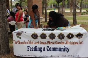 FAC signing up food recipients at Tom Wussow Park
